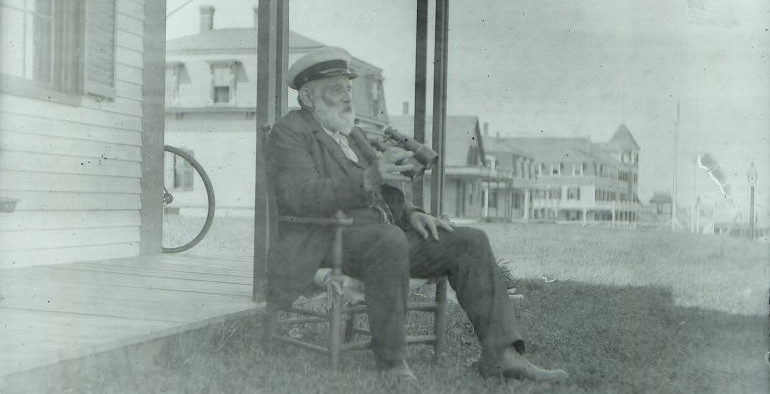 Sea Captain on front porch, looking out at the ocean.